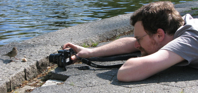 Photo of Tim phoographing a bird